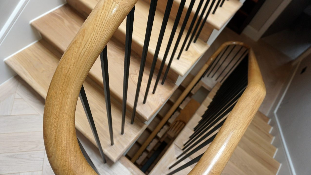 Flowing stylish finish in this staircase handrail installation in Wilmslow Cheshire by PT Handrails, Clive Durose