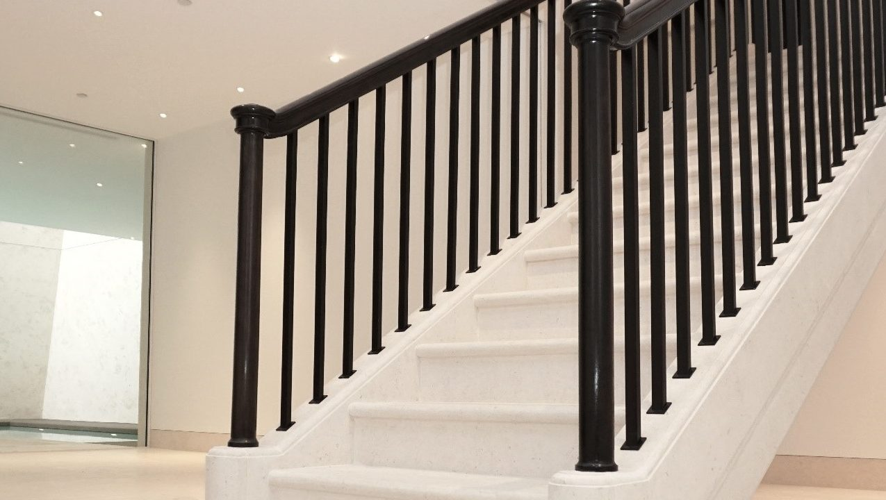 Newel staircase rail posts close up by Precision Timber Handrails